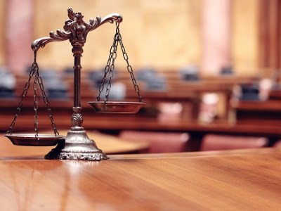 Employer faces Court after allegedly threatening staff
