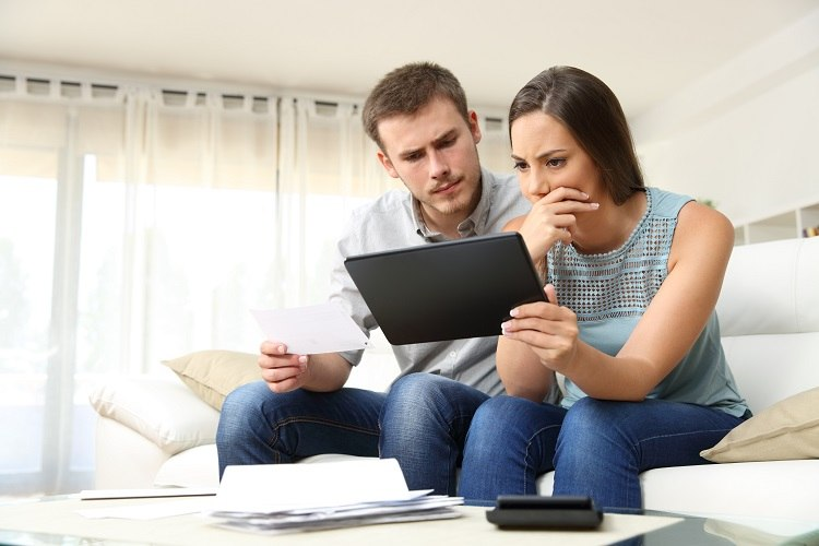 A couple seriously consider their options before buying their first home