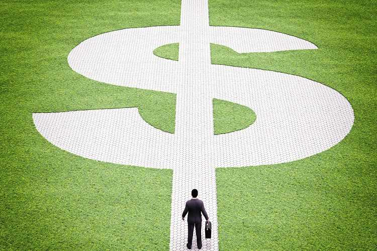 Businessman walks down the financial path