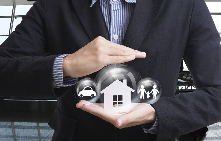 A businessman presents home and car loan options