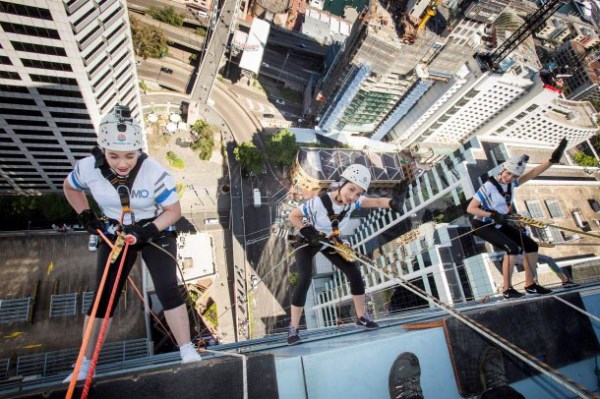 Mills Oakley lawyers abseil for disadvantaged youth