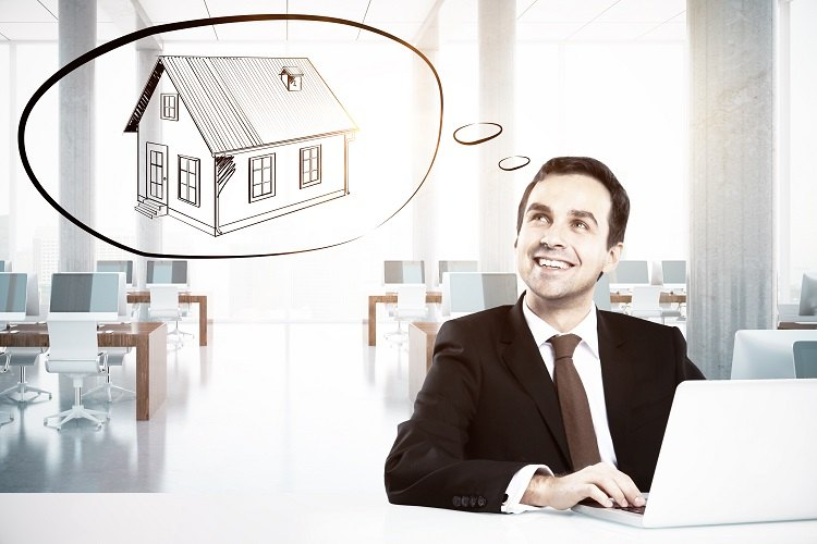 Man at desk thinking about types of property