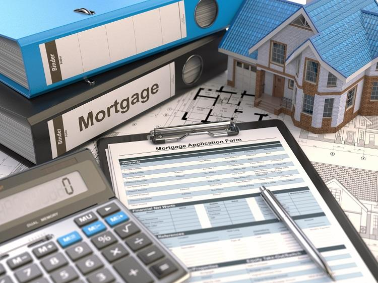 A property investor's tools: a mortgage application and binders