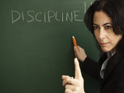 Does strict discipline pay off in the classroom?