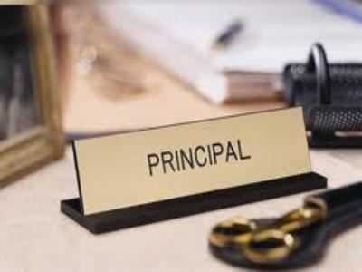 Former principal cleared in corruption case