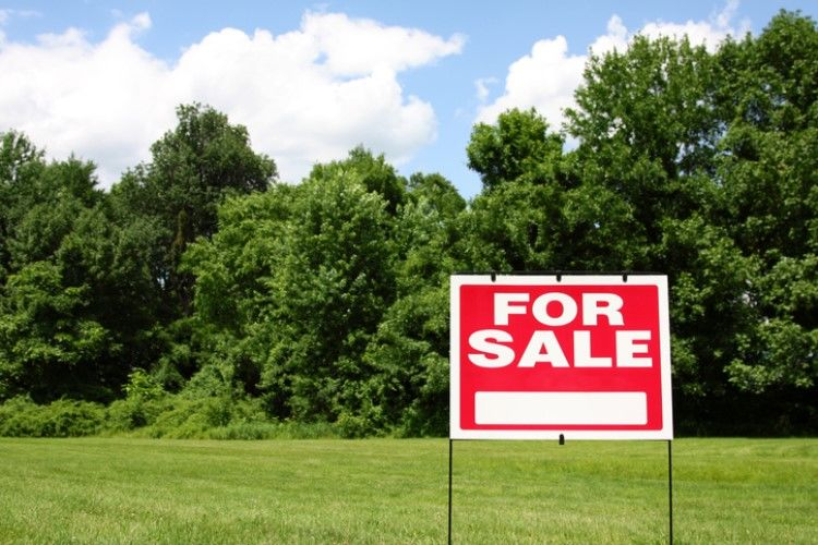 Residential land sales in the first three months of the year set a new record low as demand for homes waned.