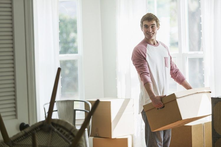 A young man moves into his first home