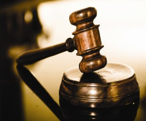 Insurance broker pleads guilty to theft