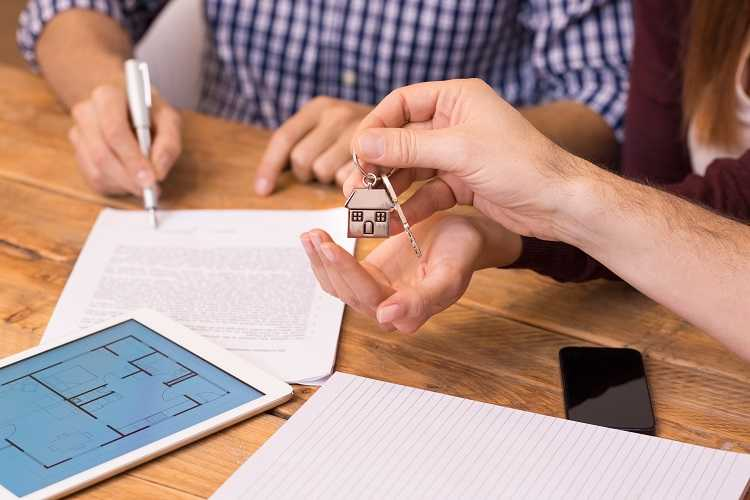 Keys to a home and a mortgage application