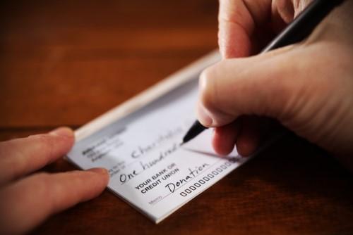 Broker donates portion of funds to combat violent crime