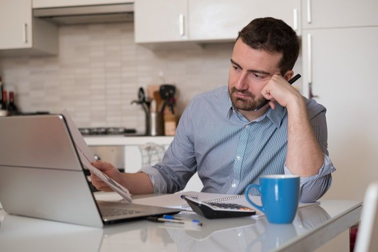 A man with bad credit applies for a mortgage online